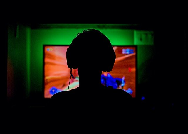 A screen shot of a video game in a dark room watching television