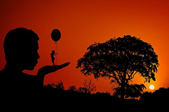 A person standing in front of a sunset